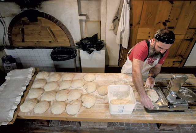 Trent Cooper by portioning and shaping naturally leavened bread - GLENN RUSSELL