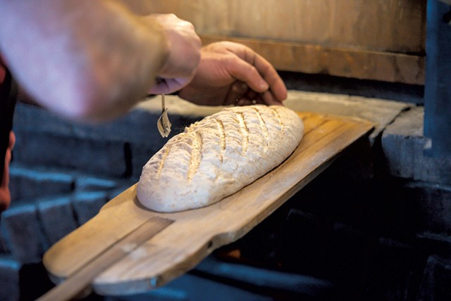 Mark a bâtard of sourdough before putting it in the oven - GLENN RUSSELL