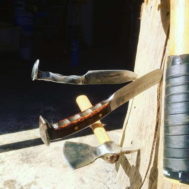 """""""Curing linseed oil in the sun."""" Knives crafted from Railroad Spikes. - COURTESY OF SUNRISE FORGE"""
