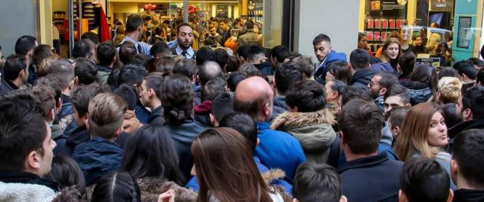 Thessaloniki, Greece - November 25, 2016. People wait outside a department store during Black Friday shopping deals, at the northern Greek city of Thessaloniki.