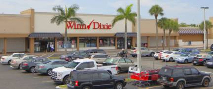 HALLANDALE - JUNE 15: RK Plaza shopping center located in Hallandale Beach with anchor tenant Winn-Dixie shot with an elevated pole June 15, 2016 in Hallandale FL, USA