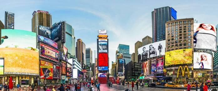 NEW YORK, USA - OCT 21, 2015: people visit Times Square, featured with Broadway Theaters and huge number of LED signs, is a symbol of New York City and the United States.