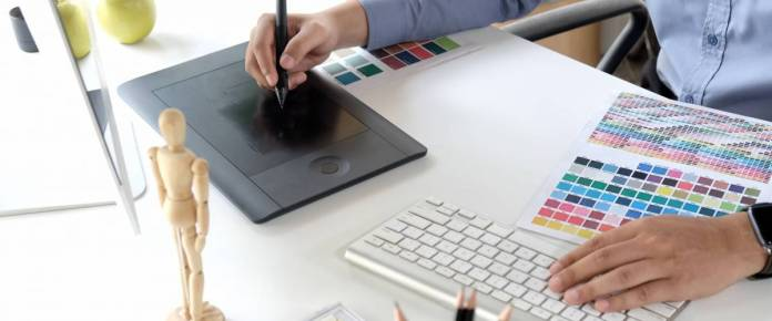 art student working on graphic design tablet