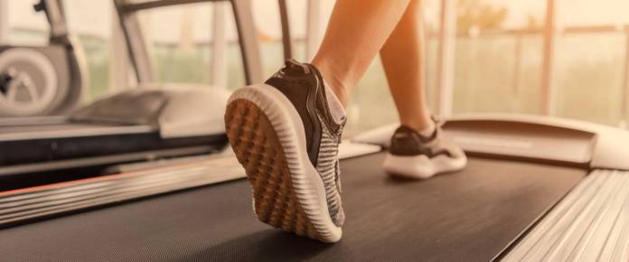 close up of woman's feet running on a treadmill