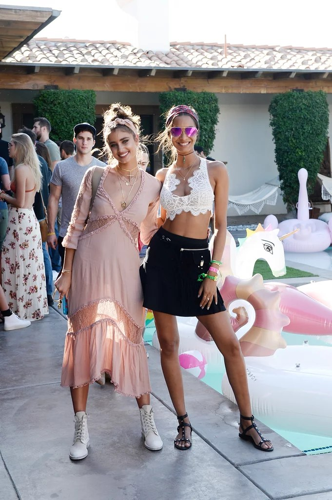 Taylor Hill wore a For Love & Lemons dress with combat boots and Lais Ribeiro wore a lacy bralette and miniskirt to the Angel Oasis.