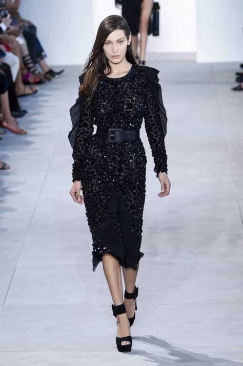 Bella Hadid wore Chrissy's dress down the runway at New York Fashion Week on Sept. 14.