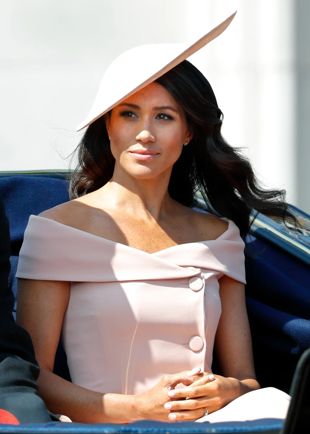 LONDON, UNITED KINGDOM - JUNE 09: (EMBARGOED FOR PUBLICATION IN UK NEWSPAPERS UNTIL 24 HOURS AFTER CREATE DATE AND TIME) Meghan, Duchess of Sussex travels down The Mall in a horse drawn carriage during Trooping The Colour 2018 on June 9, 2018 in London, England. The annual ceremony involving over 1400 guardsmen and cavalry, is believed to have first been performed during the reign of King Charles II. The parade marks the official birthday of the Sovereign, even though the Queen's actual birthday is on April 21st. (Photo by Max Mumby/Indigo/Getty Images)