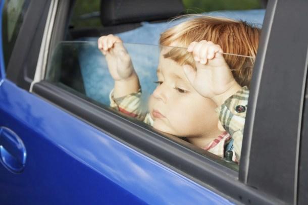 Image result for sad child left alone in car