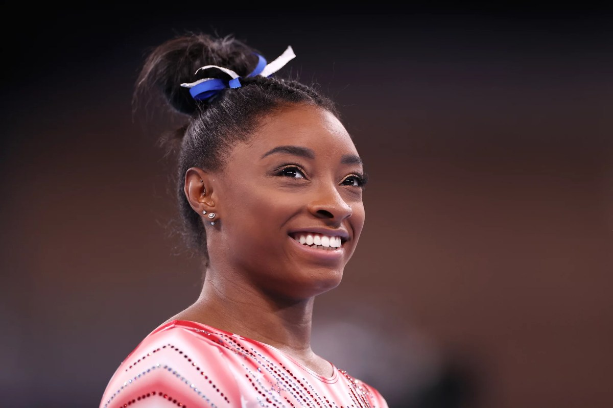 TOKYO, JAPAN - AUGUST 03: Simone Biles of Team United States looks on during warm-ups prior to the Women's Balance Beam Final on day eleven of the Tokyo 2020 Olympic Games at Ariake Gymnastics Centre on August 03, 2021 in Tokyo, Japan. (Photo by Laurence Griffiths/Getty Images)