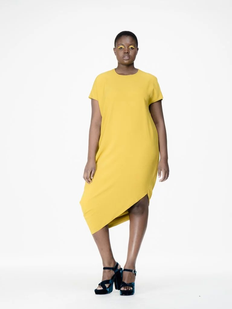 You'll love the asymmetric cut of Universal Standard's Augusta Geneva Dress in Mustard ($180)