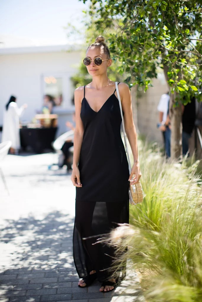 Nicole Richie kept it simple in a black tank dress with a sheer skirt at the House of Harlow 1960 x Revolve brunch.