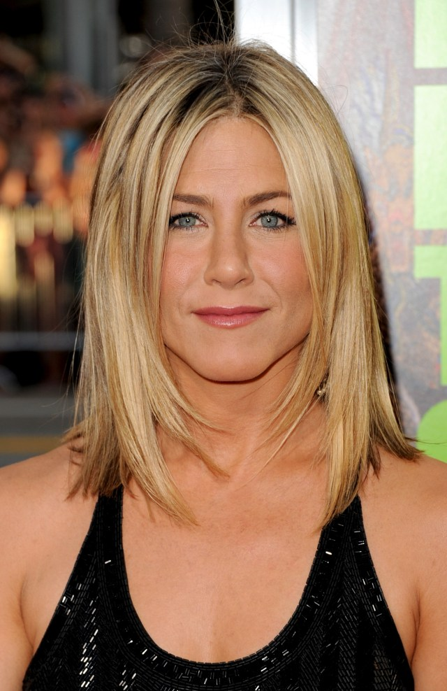 jennifer aniston's hair: from 'the rachel' to her signature 'do