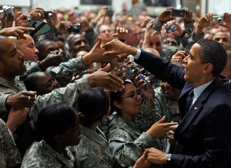 Image result for Obama reviewing the troops