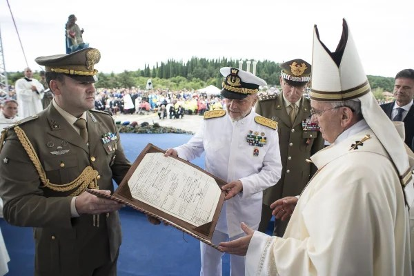 Image: Pope Francis receives the matriculation document of his grandfather Giovanni Carlo Bergoglio, during a mass at Redipuglia Military Sacrarium to mark the centenary of World War One, in Redipuglia