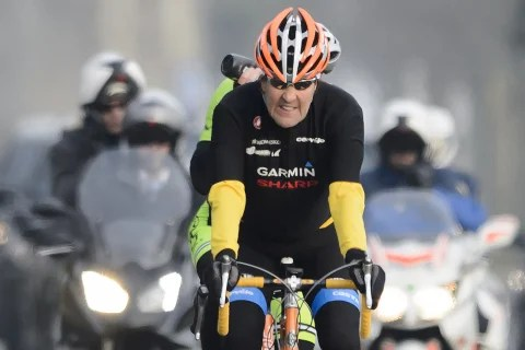 Image: John Kerry rides his bike during a break in Lausanne, Switzerland, in March.