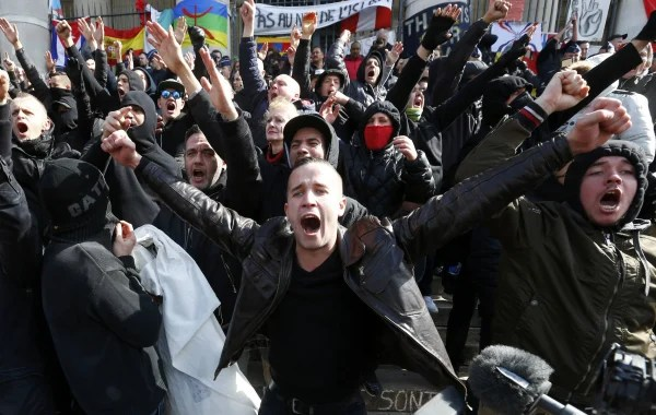 Image: Right-wing demonstrators protest against wave of terrorism in frront of the old stock exchange in Brussels