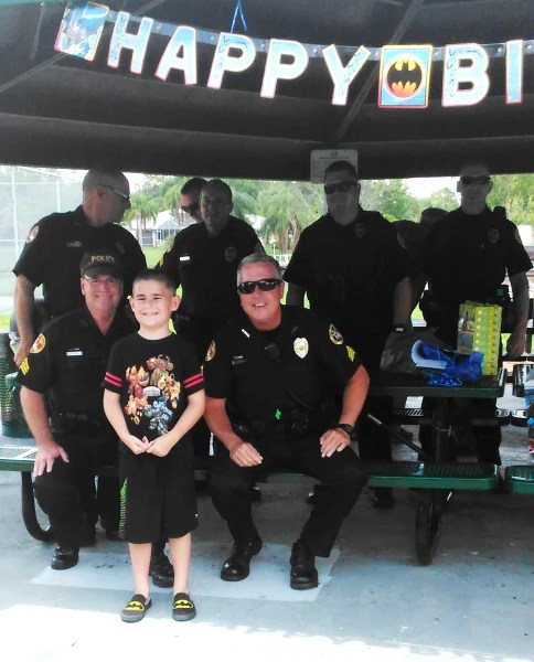 Police surprise boy with autism at birthday party after no one RSVPs.
