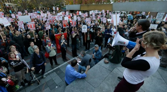 Seattle's Socialist Alternative organize anti-Trump rally. Note the manufactured signs and the hammer & sickle logo.