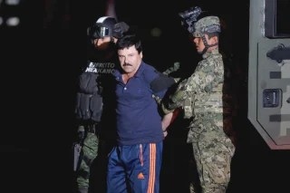 "Image:Joaquin ""El Chapo"" Guzman is escorted by soldiers during a presentation in Mexico City, Jan. 8, 2016."