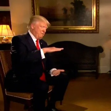 Image: Trump gestures during his interview with Fox Business Network's Maria Bartiromo to illustrate the size of the
