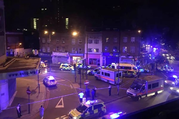 Image: Police vehicles at the scene where a vehicle hit pedestrians in north London