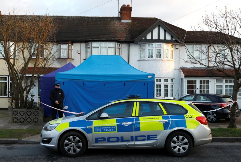 Image: A police officer stands guard outside the home of Nikolai Glushkov