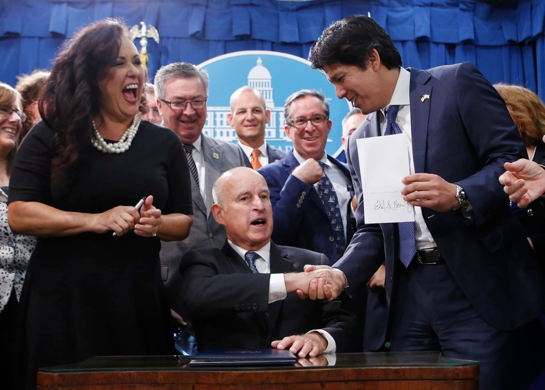 California aims to be entirely green powered by 2045, as Gov. Jerry Brown signs SB 100