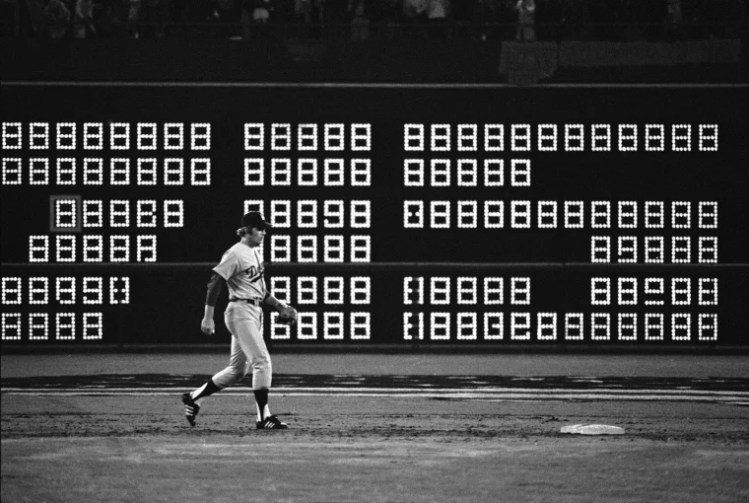 "The scoreboard flashes ""715"" seconds after Hank Aaron hit his recording breaking 715th home run in 1974."
