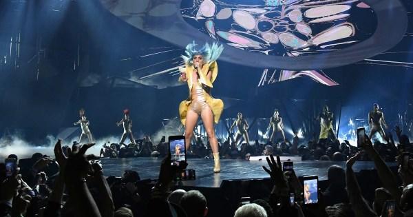 Lady Gaga falls off stage in fan