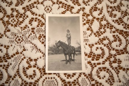 Image: Danielle Stephens riding a horse on the family ranch in Kingman