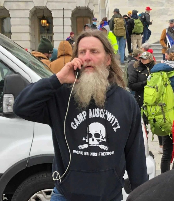 Man in 'Camp Auschwitz' shirt, photographed at U.S. Capitol riot, arrested  in Virginia