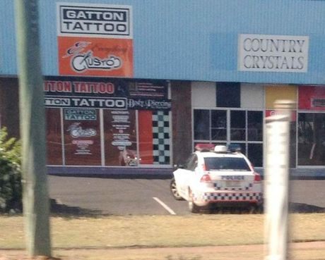 """Police keep surveillance over Gatton Tattoos, owned by Life and Death Motorcycle Club chapter president Tony """"Bones"""" Lowe until he sold it to his son last week. Police across the state have been told to keep a visible presence outside gang-affiliated tattoo parlours which have been made off-limits to members."""
