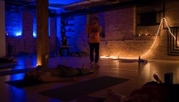 Andre Foisy leading students at Augusts Metal & Candlelit Yoga session