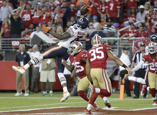 A leaping Brandon Marshall snares a second-quarter touchdown pass last night against the 49ers. He added two more TDs later.
