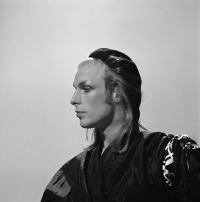 Brian Eno as a young man dressed as a woman.