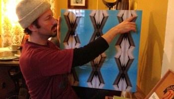 Christopher Shoup shows off the piece he took into two museums last year.