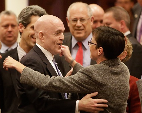 Illinois Rep. Greg Harris, left, is congratulated by lawmakers as gay marriage legislation passes on the House floor during veto session Tuesday.