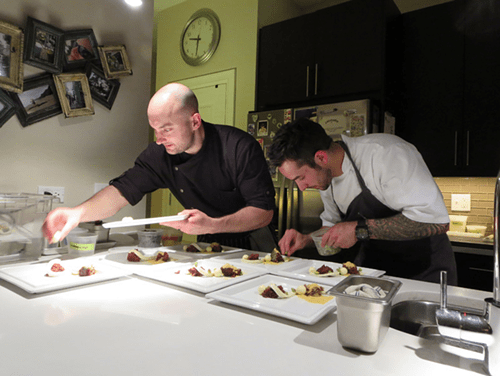 Jake Bickelhaupt (left) in his apartment kitchen for a Sous Rising dinner.