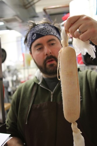 Josh holds the finished torchon.