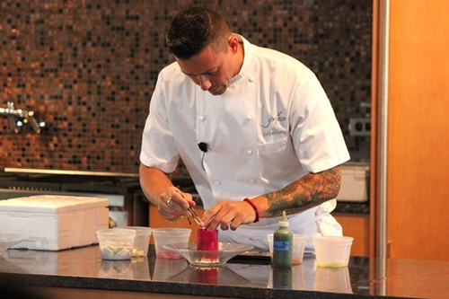 Plating hamachi ceviche inside the prickly pear ice cylinder
