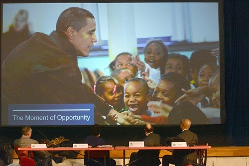 Presenters and the audience watched a video presentation at a Park District hearing on the Obama Presidential Library.