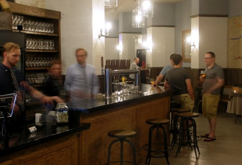 Thats owner Paul Leamon behind the bar, blurry and wearing a blue shirt.