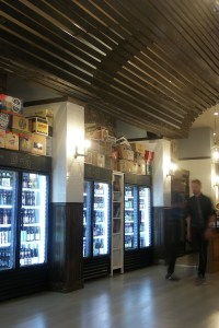The entryway is flanked with coolers full of individual bottles and cans, alphabetized by brewer.