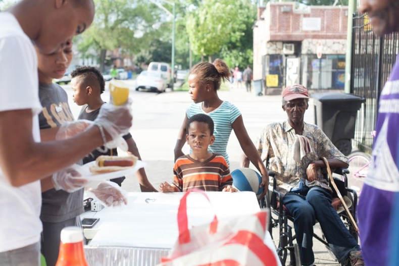 "Mothers Against Senseless Killings serves dinner daily on an Englewood corner that was once a hotspot for violence. ""The only reason I know that we don't necessarily need the police is because of what I do every day,"" says MASK founder Tamar Manasseh. - DANIELLE A. SCRUGGS"