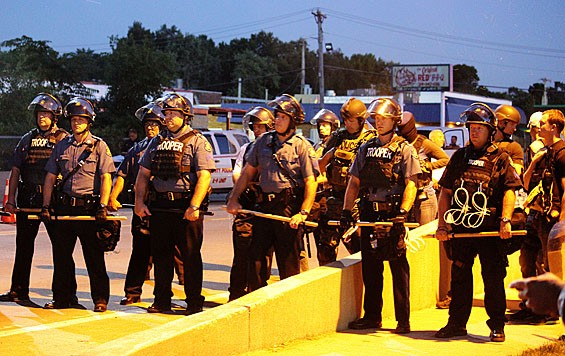 Officers in a picket line during the early August protests on West Florrisant Avenue. - DANNY WICENTOWSKI