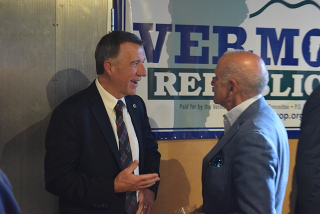 Gov. Phil Scott (left) talking to his former Republican primary rival, Bruce Lisman - TERRI HALLENBECK