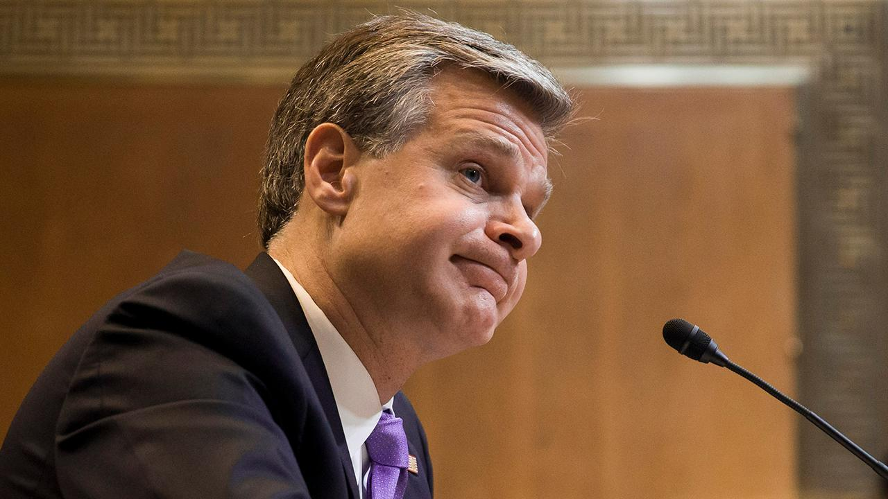 Christopher Wray on if the FBI engages in spying: 'That's not the term I would use'
