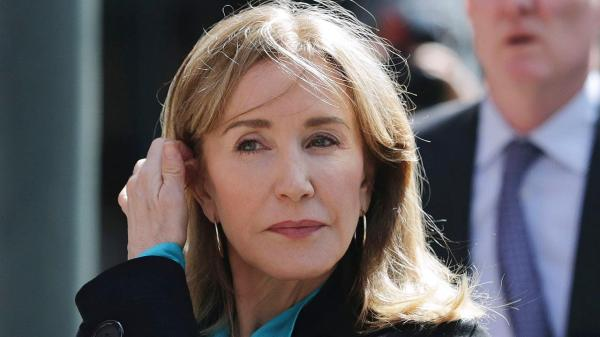 Felicity Huffman reports to prison for her role in the college admissions scandal