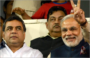 Paresh Rawal with Gujarat Chief Minister Narendra Modi. File photo: PTI.
