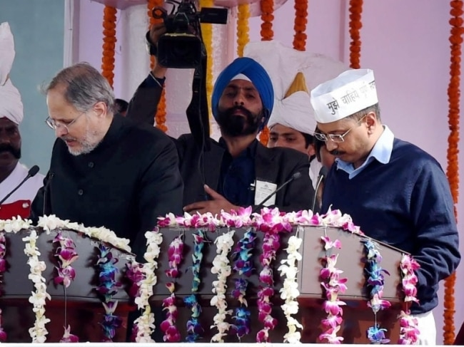 """<a href=""""http://indiatoday.intoday.in/people/arvind-kejriwal/17736.html"""">Arvind Kejriwal</a> takes oath as Delhi CM. Photo: PTI."""
